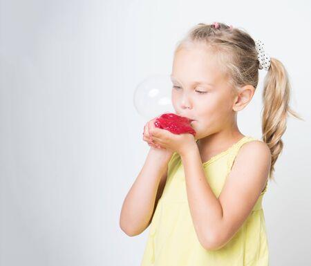 Happy joyful girl playing a red slime