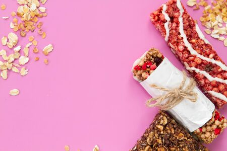granola bars on pint background - diet and breakfast