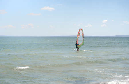 Recreational Water Sports. Windsurfing. Windsurfer Surfing The Wind On Waves In Ocean, Sea. Extreme Sport Action. Recreational Sporting Activity. Healthy Active Lifestyle. soft focus