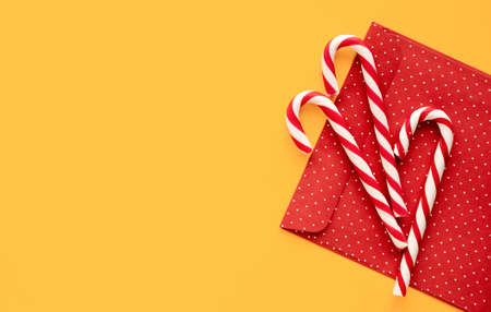 Christmas mint candies on yellow  with gift envelope
