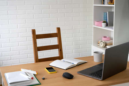 empty workplace with laptop and office supplies. concept of work and study at home.