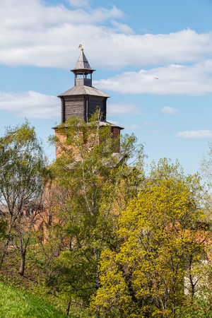 congress center: Clock tower of the Kremlin behind the trees in Nizhny Novgorod in the spring