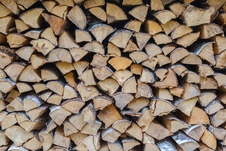 Firewood in woodpile Stock Photo
