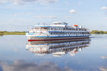 breadth: Passenger ship is on a quiet river