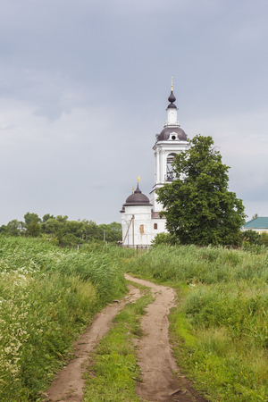View of the Church of St. Nicholas in the Abraham Epiphany Monastery from a dirt road in Rostov Veliky, Yaroslavl Region