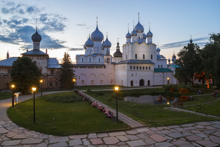 Church of the Hodegetria and the Resurrection and the Assumption Cathedral in the evening in the Kremlin of Rostov the Great Фото со стока