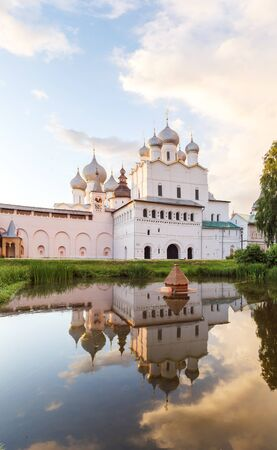 Resurrection church with reflection in the pond in the Rostov Kremlin in the sunset light
