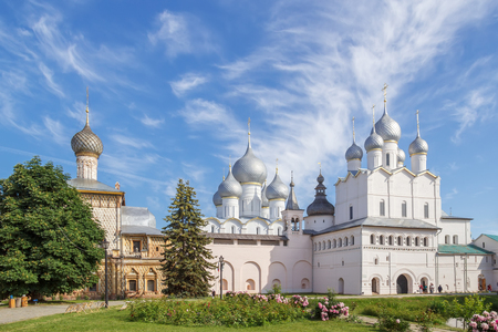 Church of the Hodegetria and Resurrection and the Assumption Cathedral in the Kremlin of Rostov the Great on a sunny day Фото со стока