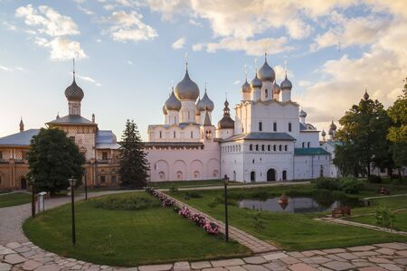 Church of the Hodegetria and the Resurrection and the Assumption Cathedral in the sunset in Rostov the Great Фото со стока