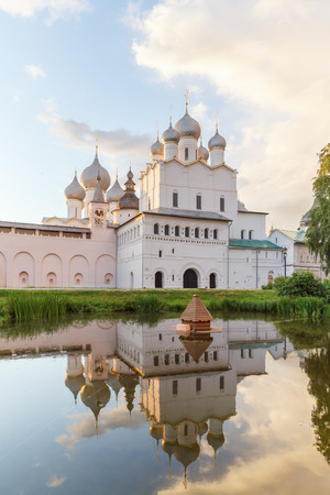 Resurrection church with reflection in the pond in the Rostov Kremlin Редакционное