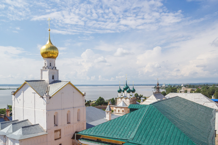 View of the Church of St. Gregory the Theologian and the Savior Not Made by Hands from the Kremlin Walls in Rostov the Great Фото со стока