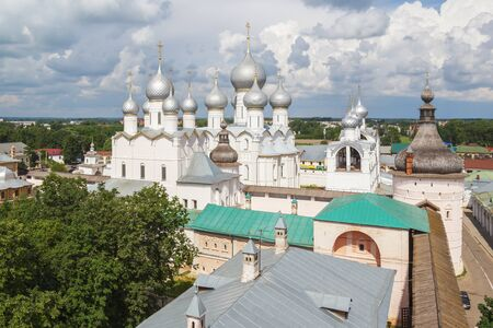 View from the wall of the Rostov Kremlin to the Resurrection Church and the Assumption Cathedral in Rostov the Great Фото со стока