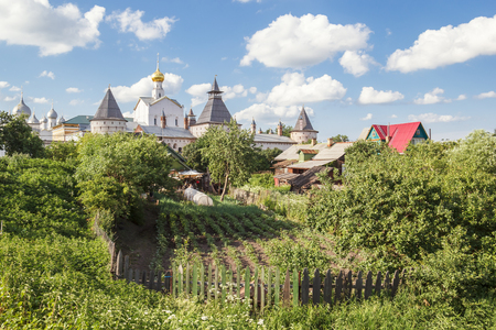 View of the Church of the Savior in the Garden and the Garden of the nearest private house in Rostov the Great Фото со стока