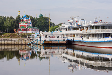 Passenger ship at the pier and the church of Dimitry Tsarevich on the blood in Uglich, Yaroslavl region