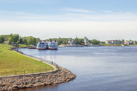 View of the berths with the ships and churches of Uglich, Yaroslavl Region Stock Photo