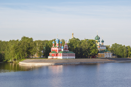 A view of the church of Dimitri Tsarevich on the blood and the Cathedral of the Transfiguration of the Savior from the boat from the river in Uglich in the morning