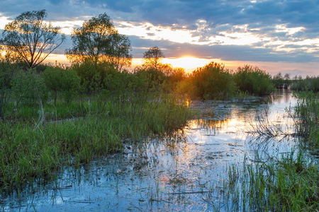 picturesque: Evening sunset view over the canal to the lake Tsevlo Stock Photo