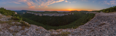 View of the slope of an adjacent plateau in the Crimean mountains at sunset Stock Photo