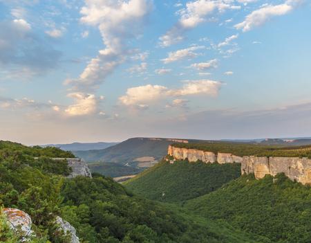 The morning light of the sun illuminates the rocks in the mountains of Crimea