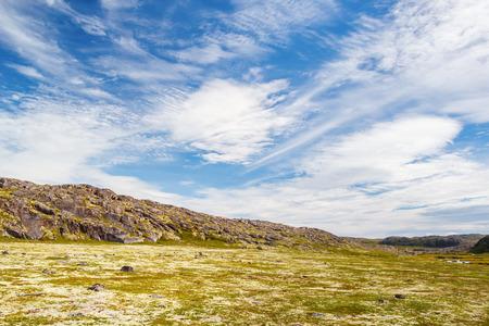 Beautiful clouds over a rocky knoll on the Kola Peninsula