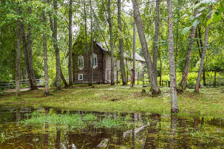 House on the shore of the pond on the Marcial Water in the Republic of Karelia in the summer, Russia