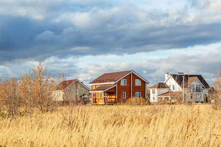 Country cottages illuminated by the sun in a autumn day Reklamní fotografie