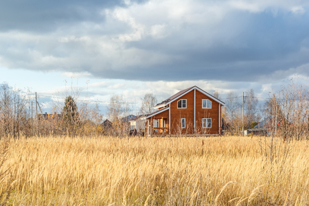 glades: Wooden country house in a sunny autumn day