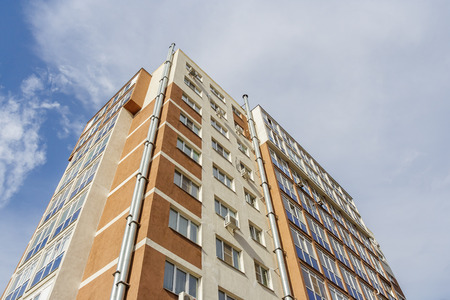 High-rise apartment house on the background of the sky