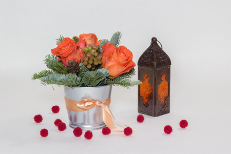 New Years bouquet of red roses, coniferous branches and a lantern with transparent background
