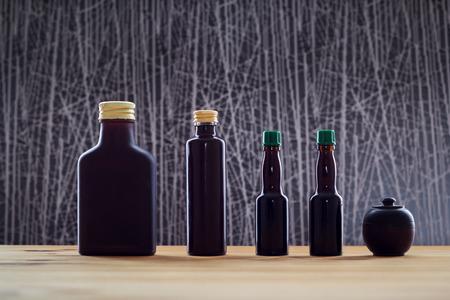 A set of bottles of dark glass in backlight