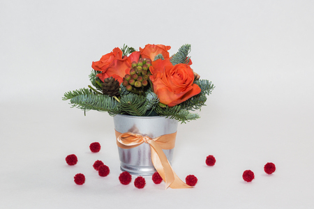 Bouquet of roses and green spruce branches with pompoms