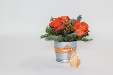 Bouquet of red roses and green fir branches