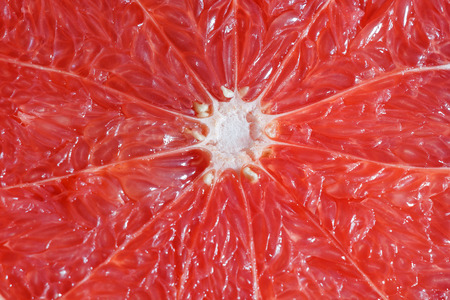Red grapefruit in the cut, background