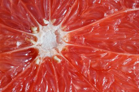 Scarlet grapefruit pulp, background