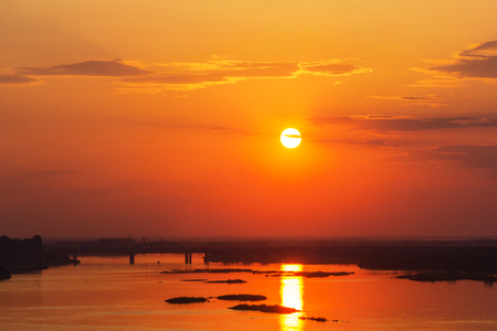 Sunset with a solar path over the river and the bridge in Nizhny Novgorod, Russia Фото со стока