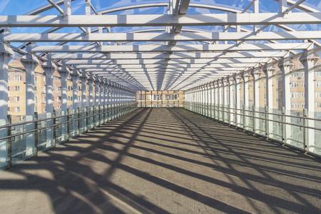Pedestrian tunnel in the light of the sun Фото со стока