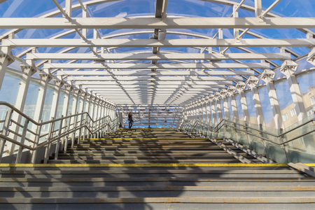 Stairway to the sunny crosswalk