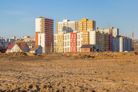 Residential built houses in a wasteland in the city