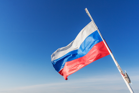 Russian flag flying in the wind against the sky