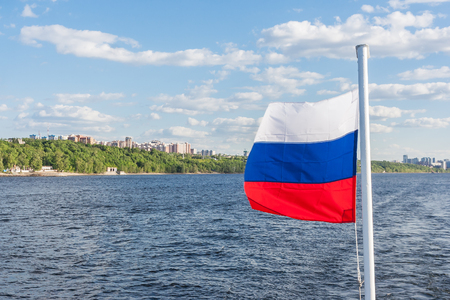 The Volga River, the flag of Russia, the city of Samara on a sunny day