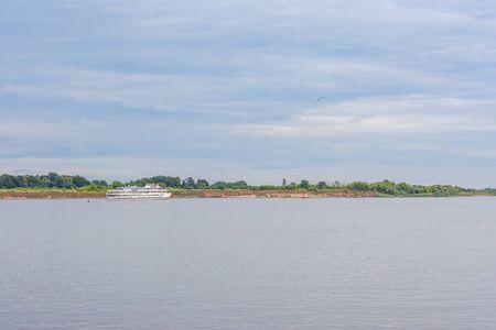 Passenger ship on the river near the shore Stock fotó