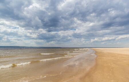 Sandy Volga coast in cloudy weather, Samara region, Russia