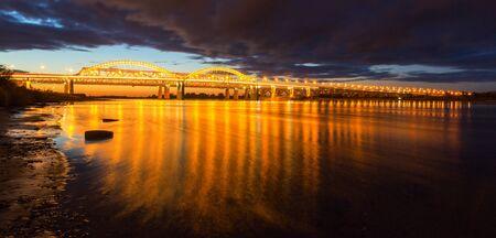 Sunset on the bridge over the Volga in Nizhny Novgorod, Russia