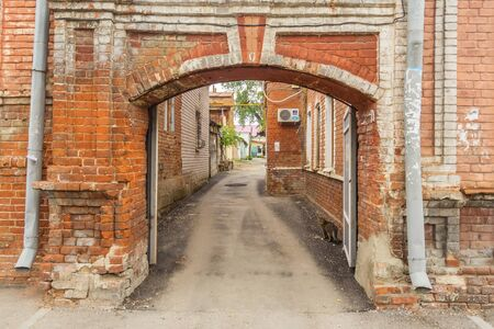 Brick arch to enter the courtyard in the Russian city