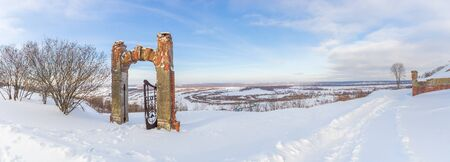 Panorama of the Oka River and the gate of an old manor in the Nizhny Novgorod region in winter