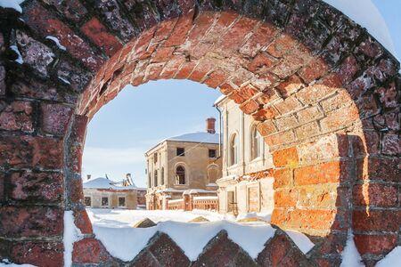 Podvyaze village, Nizhny Novgorod region/Russia - january 20 2019: View of the manor house through the fence in winter