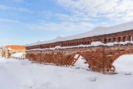 Podvyaze village, Nizhny Novgorod region/Russia - january 20 2019: Brick fence in an old manor in winter