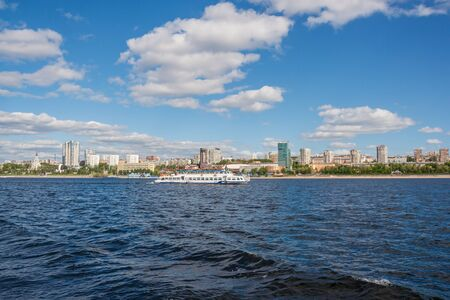 The ship goes along the shore of the city of Samara on the Volga River, Russia