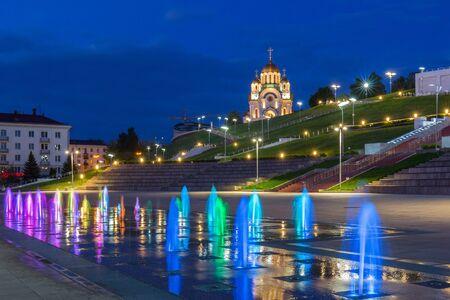 Samara city, Samara region/Russia - may 20 2019: Multi-colored jets of the fountain and St. George Church