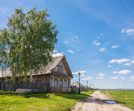 Wooden house with a tree and expensive in summer in Sviyazhsk, Tatarstan